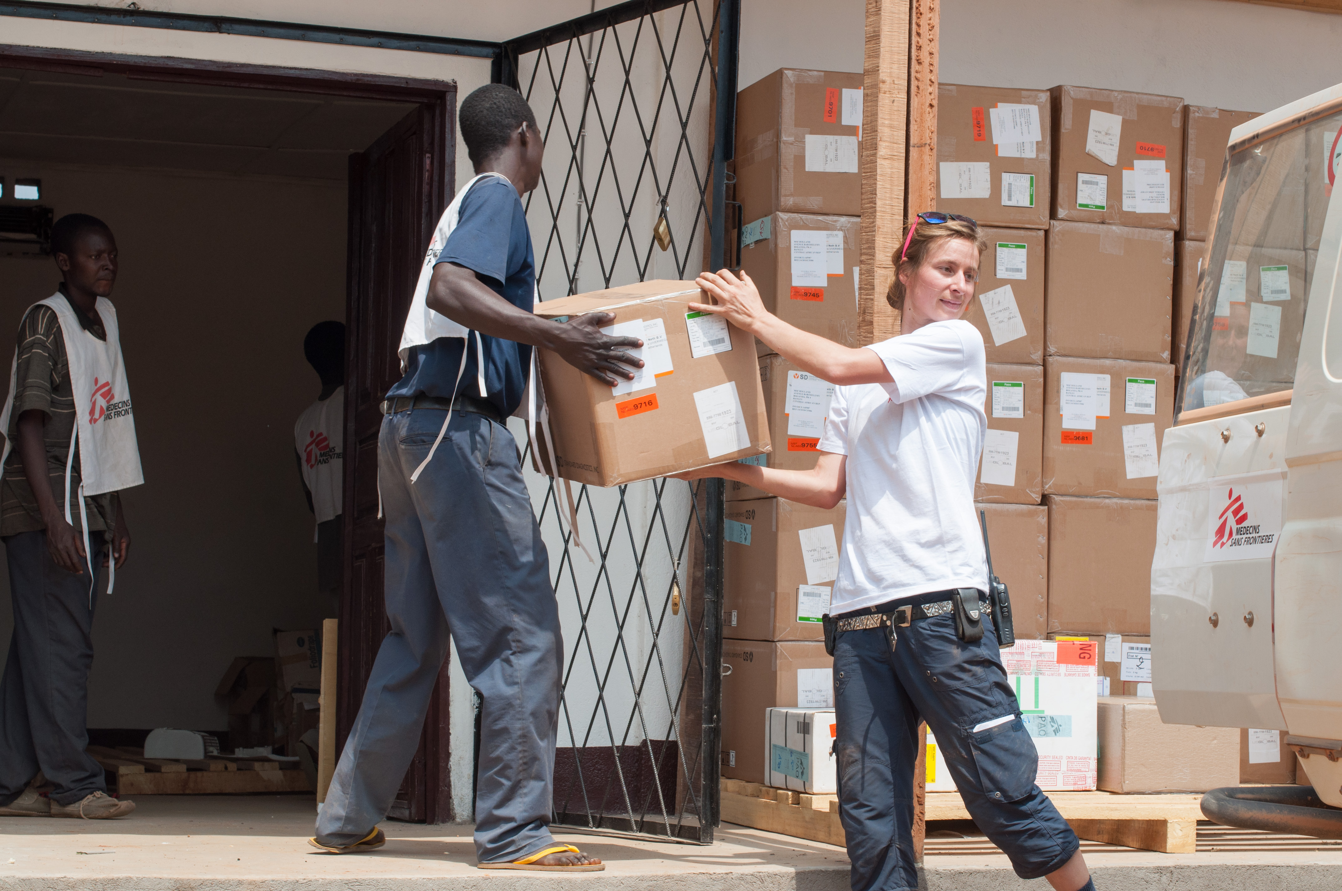 © Giorgio Contessi/MSF - MSF logistician Jennifer Bock and her colleagues store 58 boxes containing one ton of medical supplies, mainly malaria testing kits, destined for the MSF-supported health centre in Boguila, Central African Republic.