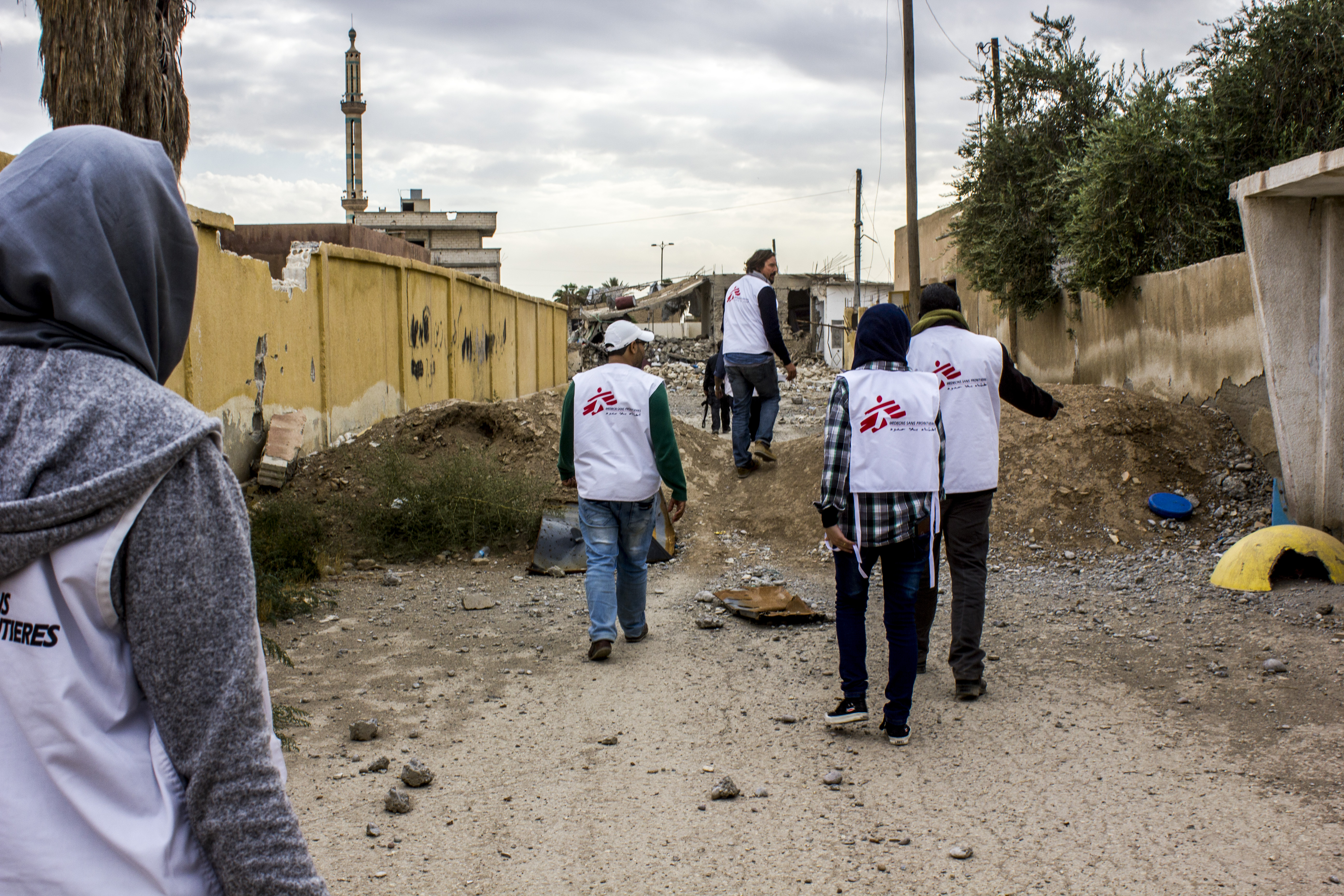 "MSF teams assessing the medical and humanitarian needs in Al Mishlab. east of Raqqa. 2 November. ""When we first visited Mishlab, east of Raqqa, it was a ghost town, but on our latest visit, some people had returned to check on their houses, Some found their homes in ruins; others found dead bodies and explosive devices in their houses, gardens and in the streets."" says Craig Kenzie, leader of MSF's Raqqa response team"