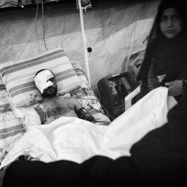 Un patient dans son lit d'hôpital © Eddy Van Wessel